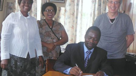 Andy signing a contract with the Kadoma authorities who are providing the land for the new centre