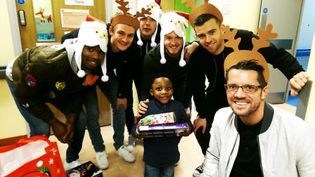 Stevenage FC players and manager Darren Sarll at the Lister children's ward