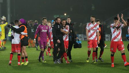 Darren Sarll and Luke Wilkinson go over to the fans with the other Stevenage players.