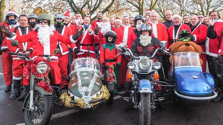 Walden Bikers pose for a group photograph before riding out of town to join the Cambridge Bikers Chr