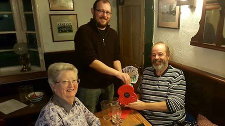 Cock pub landlord Paul Riley handing the proceeds of the Royal British Legion charity pub quiz over