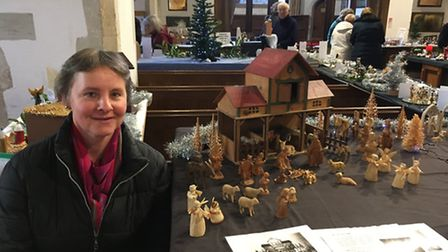 Jane Veasey with the late Mary Code's 'Crib that Grew'.