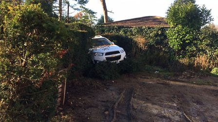 A car left the road in Rectory Lane, Stevenage, this morning and went through a hedge. Picture: Phil