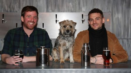 The Beer Shop joint owners Ben Hudson and John Gudgin with Wolfgang the dog.
