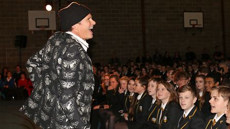 Red Hot Chili Peppers drummer Chad Smith speaks to pupils at Sandy Upper School to open their new mu