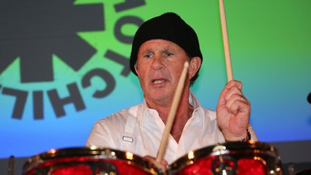 Red Hot Chili Peppers drummer Chad Smith performs a drum solo at Sandy Upper School to open their ne