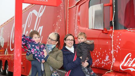 The Potschul family pose with the Coca-Cola truck.