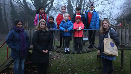 Unhappy local parents and their children in the Brook View playground.