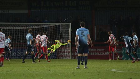 Chris Day dives in despair as Bright Osayi-Samuel curls a shot past him to open the scoring.
