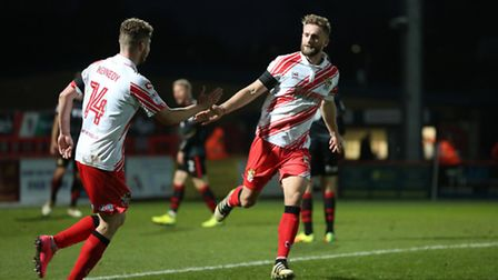 Fraser Franks celebrates making it 3-2 with Ben Kennedy. Picture: Danny Loo