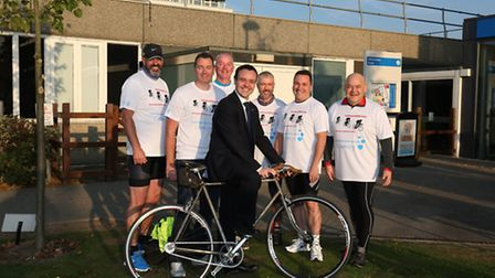 Stevenage MP Stephen McPartland with the Twintowns 1000 team outside the Lister Hospital.