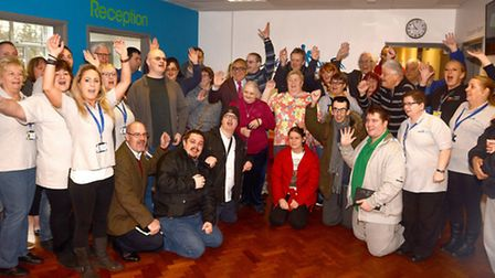 DIY SOS presenter Billy Byrne (centre) with volunteers and users at the opening of the new Jackie's
