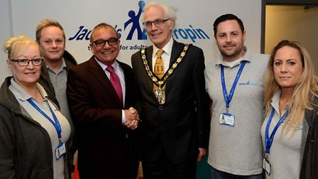 DIY SOS presenter Billy Byrne and North Herts District Council chairman John Booth shake hands at th