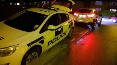 The police X5 gets set to tow the smaller police car out of the 'deeper than expected' puddle in Let