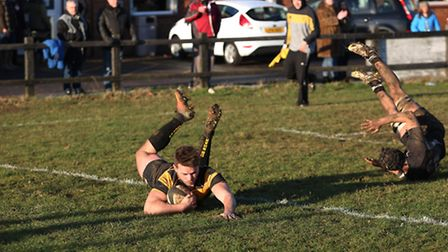Luke Campbell goes over the line to score.