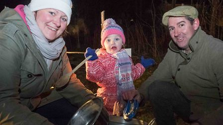 Little Macie Wood - age 2 1/2 with her mum Vikki and dad Matthew with their pots and pans with which