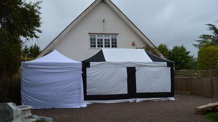 The two tents in front of the garage at Baldock Road, Royston, the larger one covering the well.