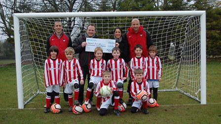 Gemma Allan presents the Ashwell Accies with a cheque for £612.