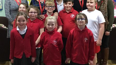 Marion Flavelle (second from left), who is retiring, with staff and pupils at Camps Hill Community P