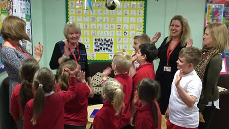 Marion Flavelle (second from left) saying goodbye to staff and pupils at Camps Hill Community Primar
