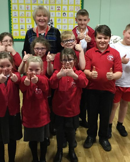 Retiring pastoral manager Marion Flavelle with pupils at Camps Hill Community Primary School in Stev