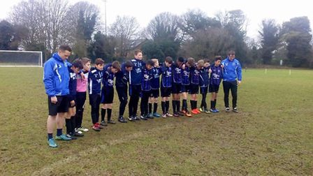 Letchworth Garden City Eagles FC players and coaches pay their respects to club pillar Vince Paige,