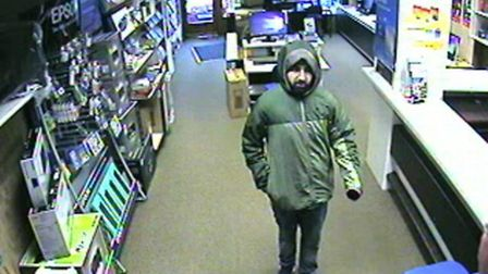 Abbas walked into the store in High Street, demanded cash and claimed he had a gun.