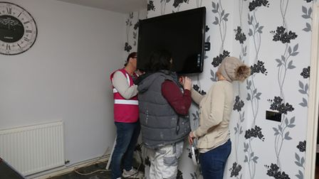The finishing touches to the living room are put in place.