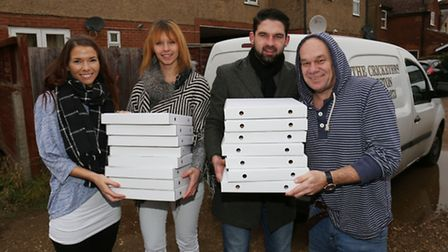 North Herts Sanctuary housing support workers Kayla Pagden (L) and Carl Williams (R) receive donatio