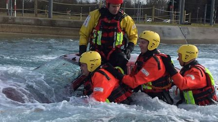 Brave firefighters practice a water rescue. Credit: Longfield TDC