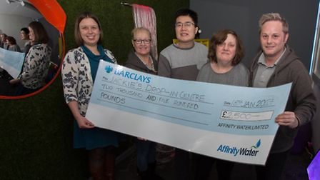 Jackie Nealon of Jackie's Drop-In accepts the £2,500 cheque from Affinity Water. Photo: Jane Alexand
