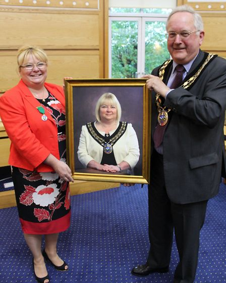 Cllr John Davey has taken over the chains of office from Cllr Stephanie Harris, the outgoing chairma