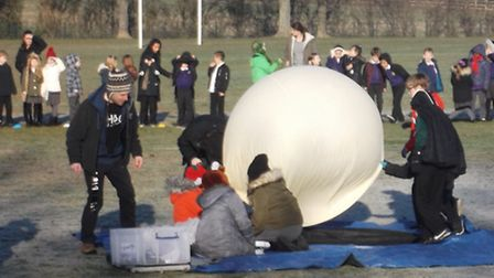 The kids get the balloon ready for launch.