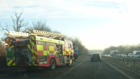 Emergency crews at the scene of the crash on the A602 between Hitchin and Stevenage.