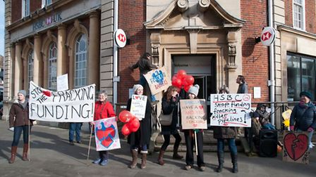 The protesters outside Letchworth HSBC on Saturday.
