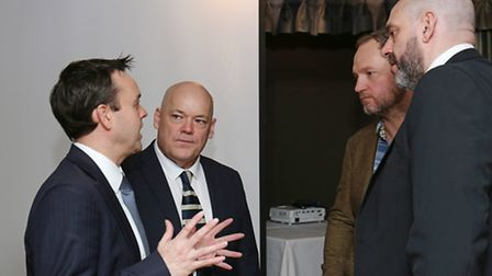 Stevenage MP Stephen McPartland speaks to some of the Twin Towns 1000 organisers at the business bre