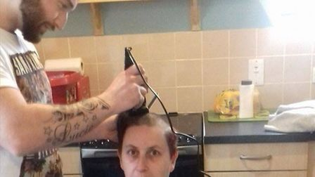 Kelly Hawkins has her head shaved by Dan Mastro to raise money for Cancer Research UK.
