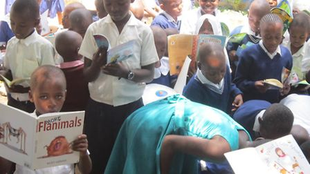 Kenyan people are enjoying the new libraries established in their communities by Just Be A Child.