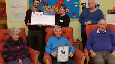 Comet editor Nick Gill hands over a cheque to Crossroads Care day centre supervisor Tracy Potts and