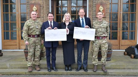 The cheque presentation at Carver Barracks with Captain Tommy Roach, Jools Holland, Melanie Mough