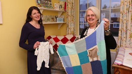 Wilbury Community Forum representative Chris Taylor (right) hands over the donated baby clothes and