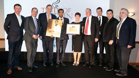 Baldock curry chef Abbas Ahmed accepts his award from Paul Scully MP during Curry Life's 15-year ann