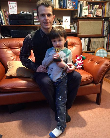 Five-year-old Thomas Seaton pictured alongside dad John with his Martins Wood's Got Talent trophy.