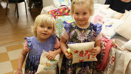 Josie Ribchester, two, and Elsie Ribchester, four, enjoy the spring fair. Photo: Karyn Haddon
