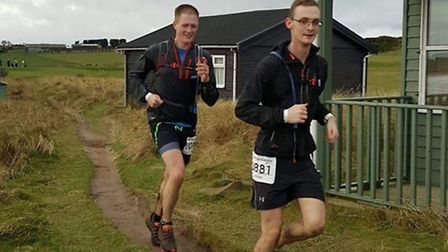 Letchworth ultramarathon runners Samuel Nobbs and George Lucas en route from Alnwick to Bamburgh Cas