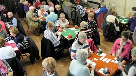 Bridge players concentrate on the game during Letchworth Howard Rotary Club's drive for Garden House