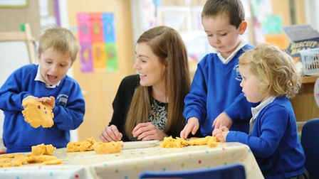 Teacher Natalie Eaton with some of the nursery children at St Swithun's VC Lower School in Sandy.
