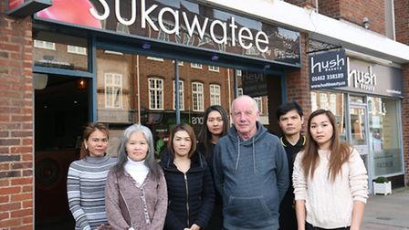 Sukawatee owner Nick Clark with his staff outside the restaurant in Hitchin which is threatened with
