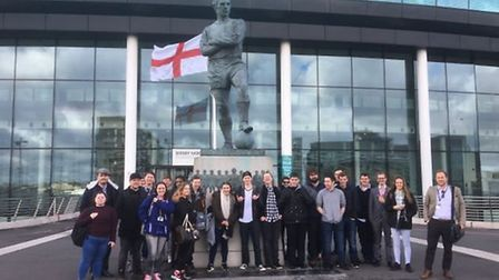 NHC students next to the Bobby Moore statue at Wembley Stadium