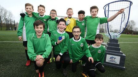 Weston Primary School's football team with their recycled water bottle medals at the Danone Nations